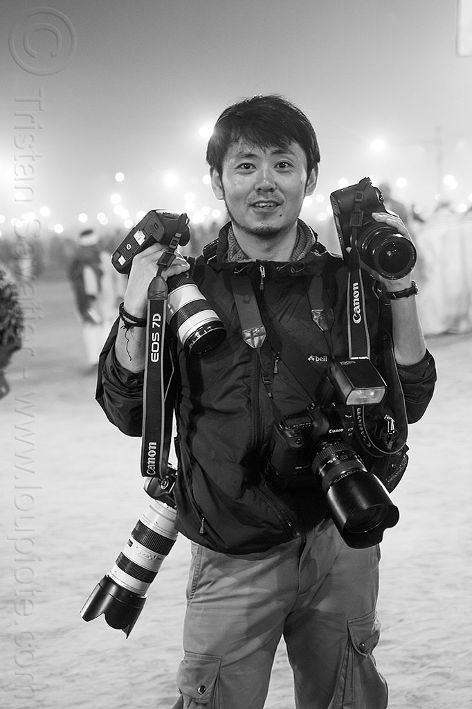 japanese professional press photographer at the kumbh mela 2013 festival (india), canon cameras, hindu, hinduism, kumbha mela, maha kumbh mela, man, press photographer, vasant panchami snan