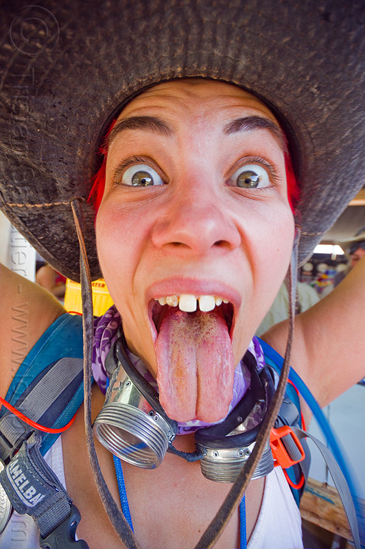 jess sticking out tongue - burning man 2012, burning man, hat, jess, media mecca, sticking out tongue, sticking tongue out, woman