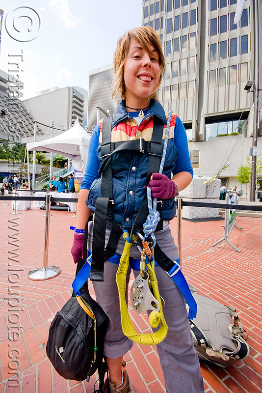 jessika is geared-up with harness and trolley - zip-line over san francisco, adventure, embarcadero, jessika, mountaineering, steel cable, trolley, tyrolienne, urban, woman, zip line, zip wire