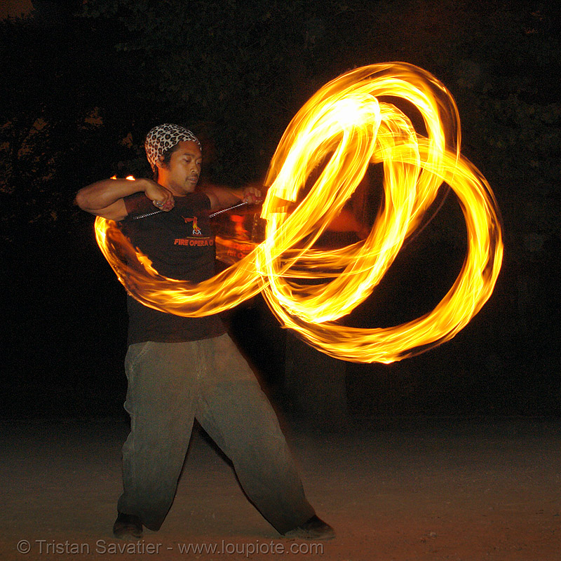 john-paul spinning fire poi at tire beach (san francisco), fire dancer, fire dancing, fire performer, fire spinning, flames, long exposure, night, people