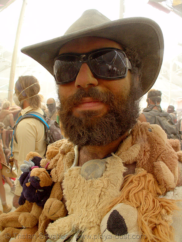 jon surdo surviving the dust storm in center camp - burning man 2007, burning man, dust storm, hat, jon surdo, sunglasses, teddy bears