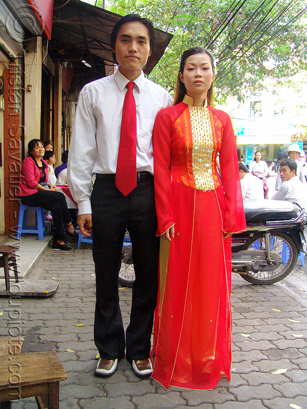 just married couple - vietnam, asian woman, dressed-up, just married, long dress, man, red dress, red tie, suit, vietnam