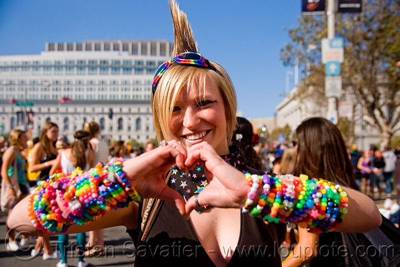 kandi kid with mohawk making a heart, beads, bracelets, clothing, fashion, goggles, jennifer, kandi cuffs, kandi kid, kandi raver, love, lovevolution, mohawk hair, woman