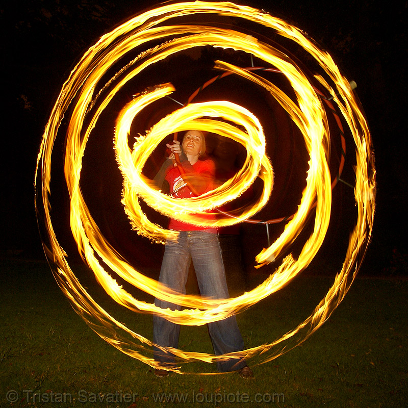 kara spinning fire hula hoop (san francisco), circle, fire dancer, fire dancing, fire hula hoop, fire performer, fire spinning, flames, kara, long exposure, night, ring, spinning fire