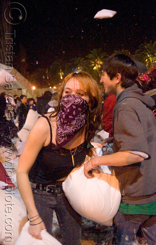 kat at the giant pillow fight (san francisco) 2009, bandana, down feathers, kat, night, pillow fight club, pillows, woman, world pillow fight day