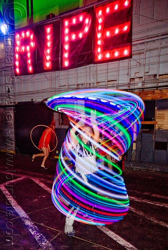 katie with glow hulahoop - ghostship halloween party on treasure island (san francisco), costume, ghostship 2009, glowing, hula hoop, led-light, long exposure, people, rave party, ripe, space cowboys