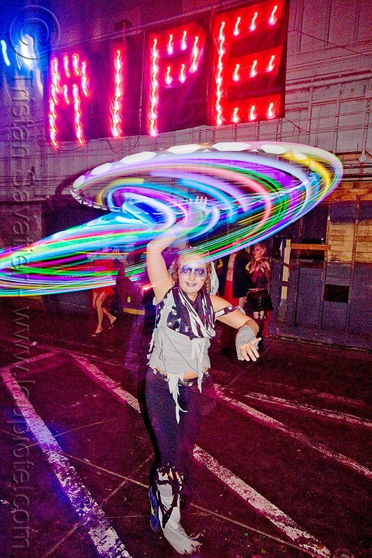 katie with glow hulahoop - ghostship halloween party on treasure island (san francisco), costume, ghostship 2009, glowing, hula hoop, led-light, long exposure, people, rave party, ripe, space cowboys, woman