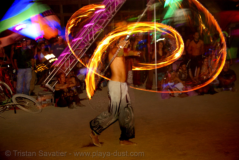 keith aka srikanta spinning a fire staff - burning man 2007, burning man, fire dancer, fire dancing, fire performer, fire spinning, flames, keith, long exposure, night, spinning fire, srikant, srikanta