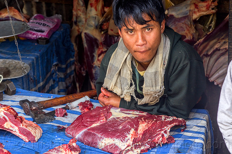 butcher with ax and beef meat in meat shop in meghalaya (india), east khasi hills, indigenous, man, meat market, people, pynursla, raw, raw meat