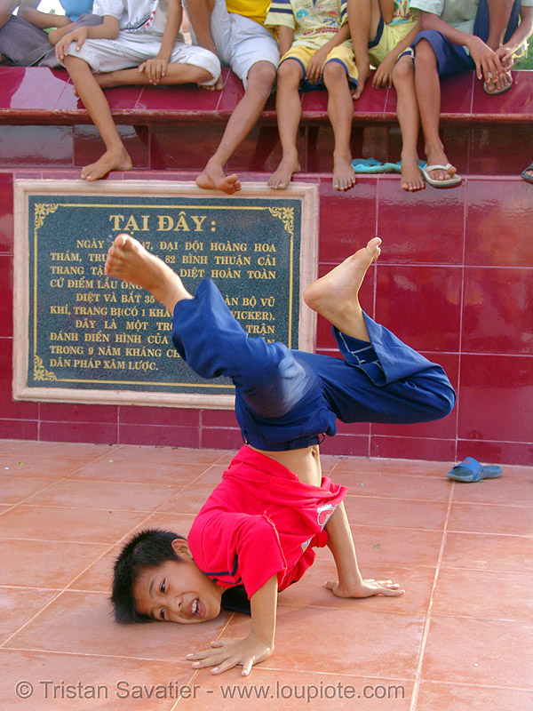 kid break-dancing - vietnam, boys, break dance, break dancing, children, communism, communist, kids, memorial, monument, phan thiet, victory