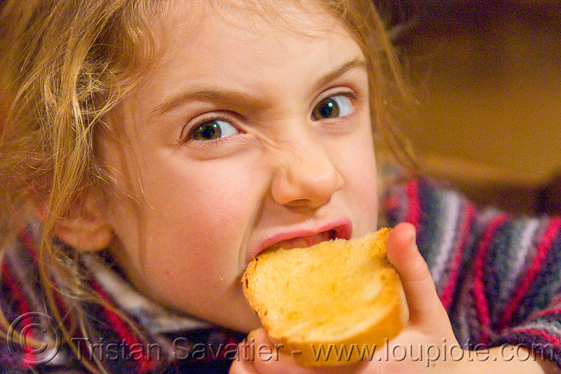 kid devouring honey toast, apolline, blonde, bread, breakfast, child, eating, girl, little girl, making faces, people, toasted bread