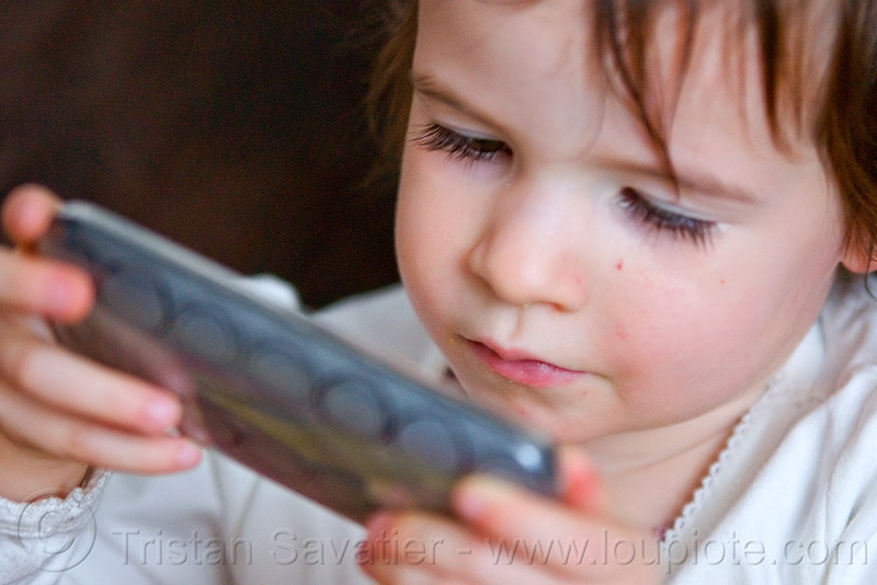 kid playing game on iPhone, cellphone, child, iphone, kid, little girl, playing, video game
