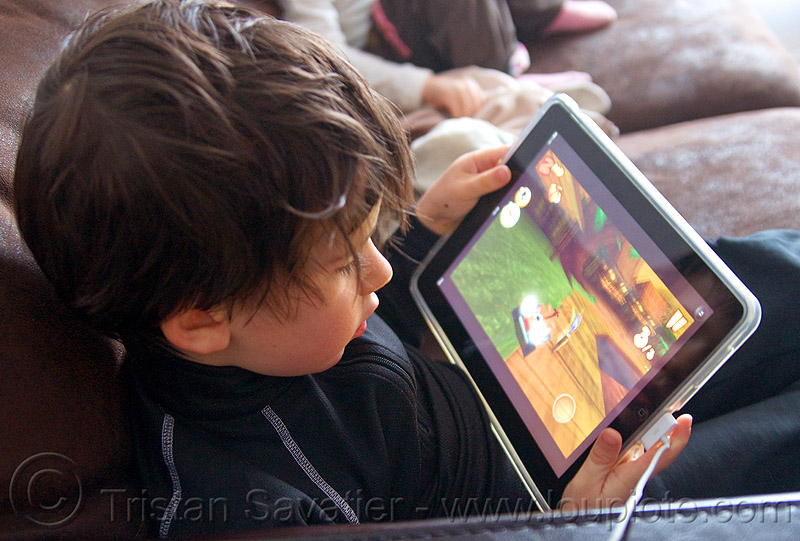 kid playing a video game on an iPad, boy, child, people, tablet computer