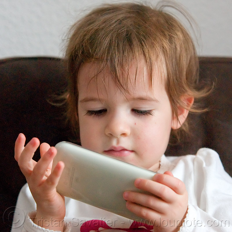 kid playing a video game on an iPhone, cellphone, child, iphone, kid, little girl, playing, video game