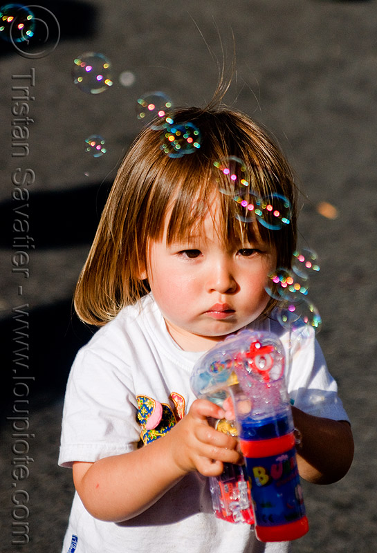 kid playing with bubble gun, boy, bubble gun, darius, haight street fair, kid, playing, small, soap bubbles, toddler, toy gun, young child