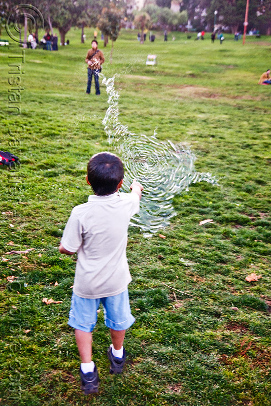 kid popping giant soap bubble, big bubble, children, dolores park, giant bubble, kids, playing, popped, popping, soap bubbles, turf