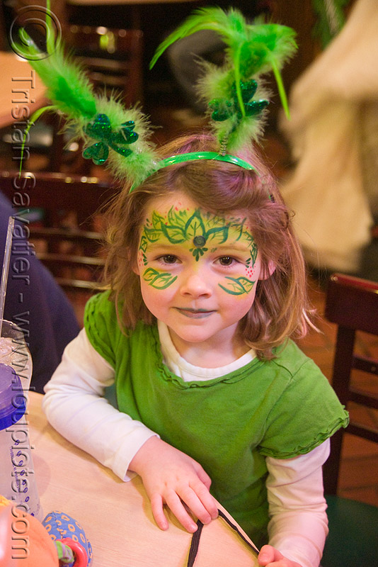 kid with green face paint - st patrick's day (san francisco), child, face painting, facepaint, girl, little girl, people, rabbit ears, st paddy's day, st patrick's day