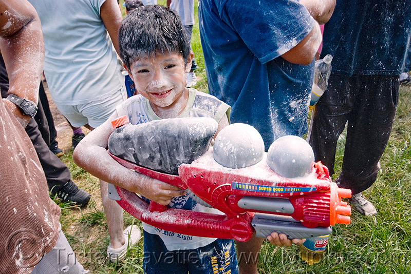 kid with watergun - super soaker - carnaval - carnival in jujuy capital (argentina), andean carnival, boy, child, man, noroeste argentino, people, san salvador de jujuy, water gun