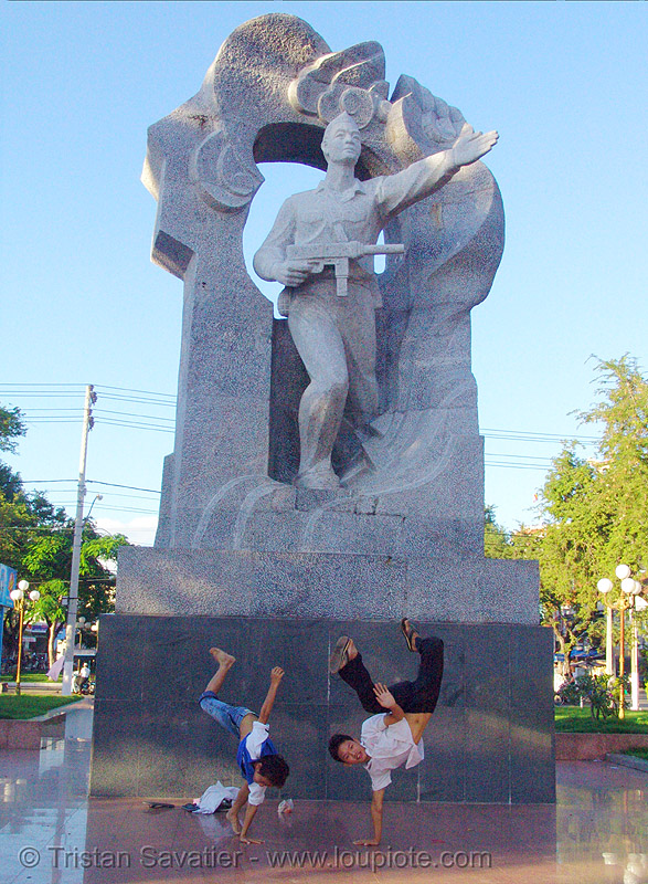 kids break-dancing in front of communist monument - nha trang - vietnam, boys, break dance, break dancing, children, communism, communist, kids, memorial, monument, nha trang, victory