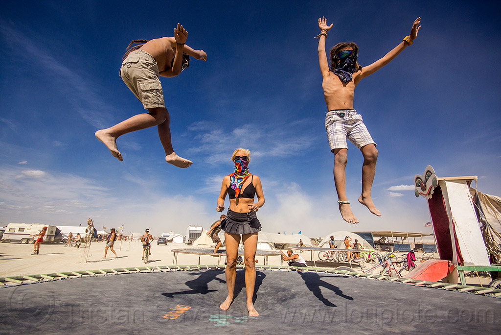 kids on trampoline - burning man 2015, bandanas, bouncing, boys, brothers, burning man, campoline camp, children, jump, jumpshot, kids, mother, trampoline, woman