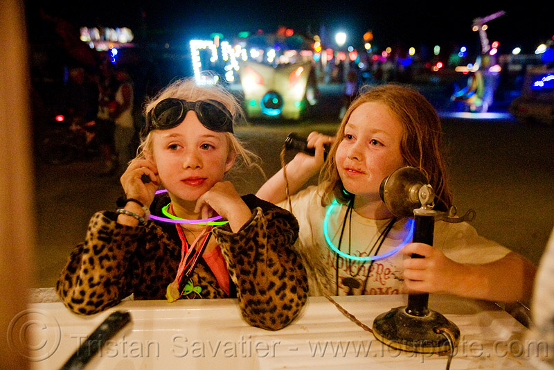 "kids playing with telephone on ""the front porch"" art car - burning man 2009, boy, children, girl, little girl, night, old, people, phone"