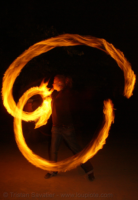 krissy spinning fire staff (san francisco), fire dancer, fire dancing, fire performer, fire spinning, flames, long exposure, night