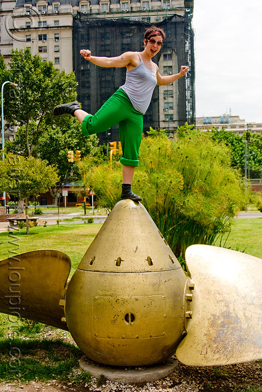 krista  playing on a giant ship propeller (buenos aires), buenos aires, krista, large boat propeller, large ship propeller, marine, monument, puerto madero, woman