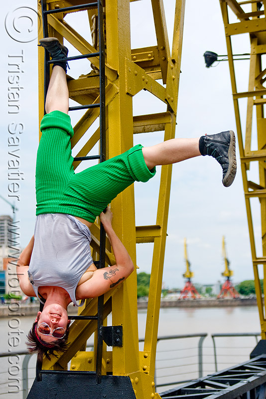 krista playing with a harbor crane, argentina, buenos aires, krista, puerto madero, upside-down, woman