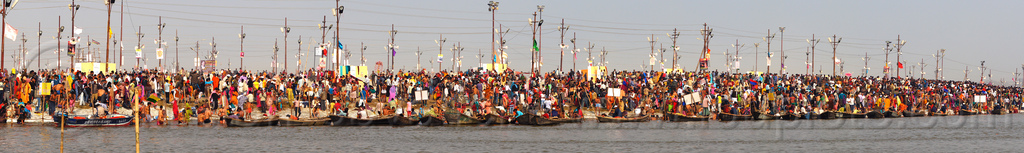 kumbh mela (india) - huge crowd gathering at sangam for the holy bath in the ganges river, crowd, ganga, ganges river, hindu pilgrimage, hinduism, india, maha kumbh mela, nadi bath, panorama, paush purnima, pilgrims, river bank, triveni sangam