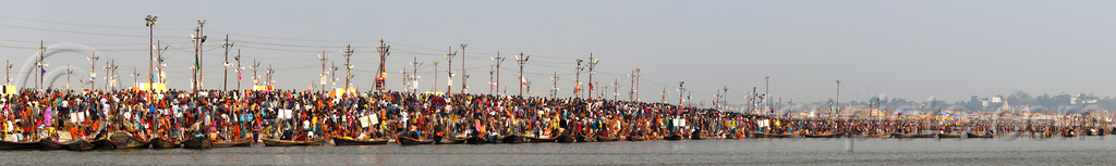 kumbh mela (india) - millions of hindu pilgrims gathering at sangam for the holy bath in the ganges river, crowd, ganga, ganges river, hindu pilgrimage, hinduism, india, maha kumbh mela, panorama, paush purnima, pilgrims, river bank, triveni sangam