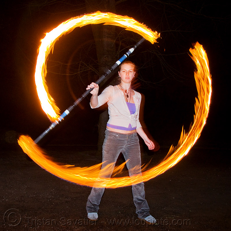 kyra spinning fire staff (san francisco), fire dancer, fire dancing, fire performer, fire spinning, flames, long exposure, night, people, woman