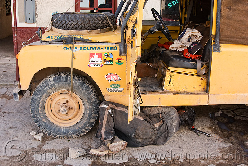 land rover - series II, 4wd, 4x4, all-terrain, expedition, fixing, land rover series ii, lorry, man, mechanic, people, repairing, touring, truck, under, uyuni, yellow