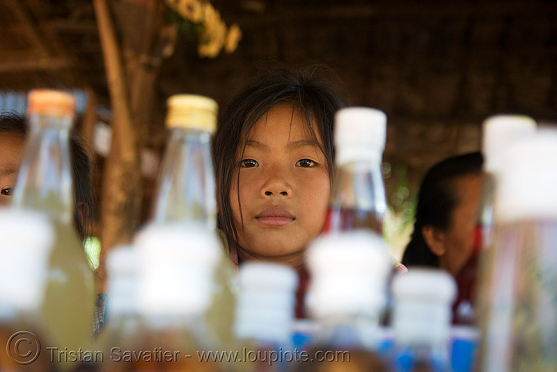laotian girl - whisky village, near pak ou caves -  luang prabang (laos), alcohol, child, kid, lao-lao, laos, liquor, little girl, luang prabang, pak ou caves temples, rice wine, vodka, whisky village