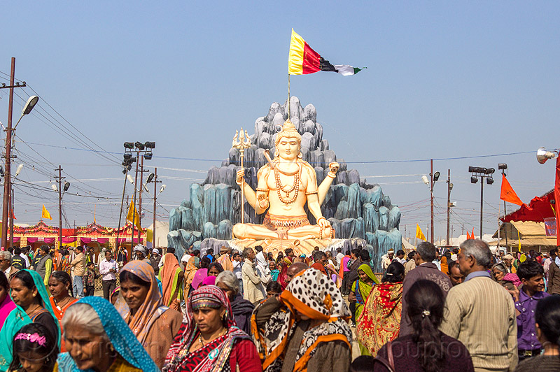 large statue of lord shiva at kumbh mela (india), ashram, ceremony, crowd, flags, hindu, hindu ceremony, hinduism, kumbha mela, maha kumbh, maha kumbh mela, people, sculpture, walking