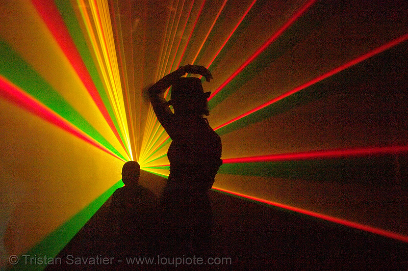 laser show - girl with hat - shadows in warehouse underground rave party, backlight, laser lightshow, laser show, lasers, nightclub, nightlife, rave lights, rave party, ravers, shadows, silhouettes, underground party, warehouse party