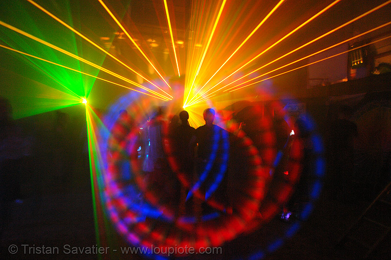 laser show - spinning lights and shadows in warehouse underground rave party, backlight, glowing, laser lightshow, laser show, lasers, led lights, night, nightclub, nightlife, rave lights, rave party, ravers, shadows, silhouettes, underground party, warehouse party