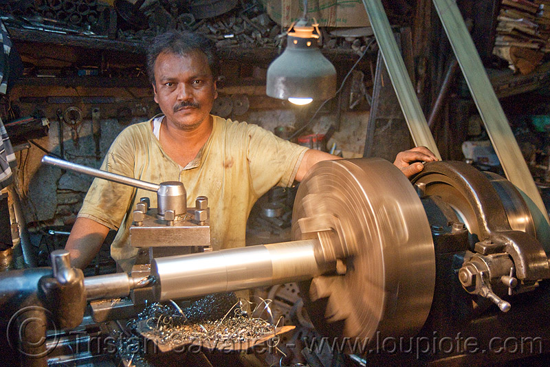 lathe and operator, delhi, machine shop, machine tools, man, mechanical workshop, metal lathe, metal shavings, mohd. yusuf & sons, operating, operator, running, spinning, turning, worker, working