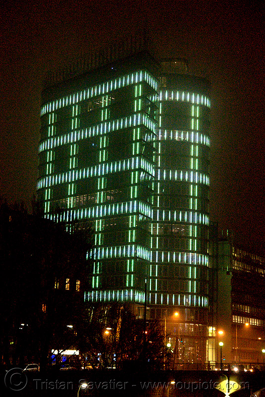 the LED-light-morphing uniqa tower in vienna, building, glowing, high-rise, led lights, morphing, night, tower, twists and turns, vienna, wien