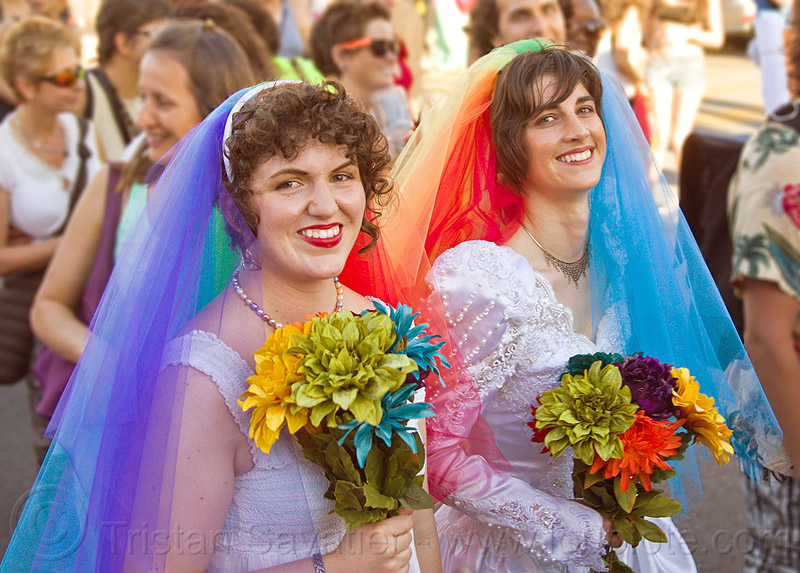lesbian couple in rainbow color wedding dresses, bridal bouquets, brides, dolores park, gay couple, gay marriage, gay pride festival, gay wedding, lesbian couple, rainbow colors, same-sex marriage, same-sex wedding, two, veils, wedding bouquet, wedding dress, wedding dresses, women