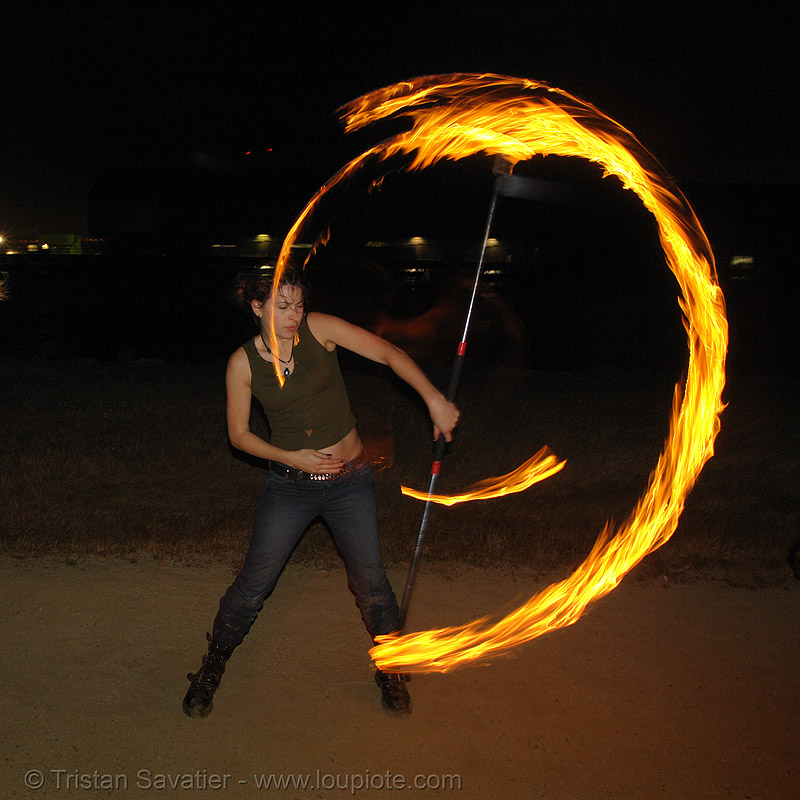 lexie spinning a fire staff, fire dancer, fire dancing, fire performer, fire spinning, fire staff, flames, lexie, long exposure, night, spinning fire
