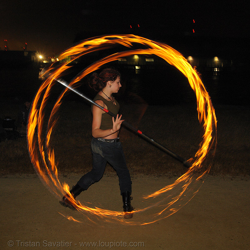 lexie spinning a fire staff, circle, fire dancer, fire dancing, fire performer, fire spinning, fire staff, flames, lexie, long exposure, night, ring, spinning fire