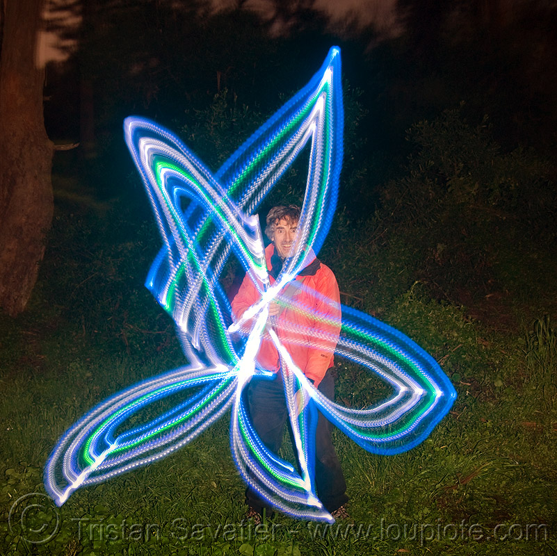 light painting - me, drawing a star with LED lights, full moon party, glowing, golden gate park, led lights, led staff, light drawing, light graffiti, light painting, man, night