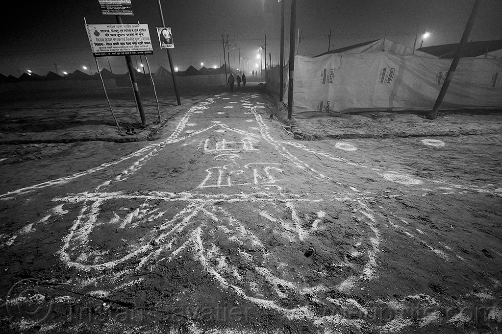 lime powder patterns and writings on the ground at kumbh mela (india), bleach powder, disinfection, drawings, hindu pilgrimage, hinduism, india, kumbh maha snan, lime powder, maha kumbh mela, mauni amavasya, night