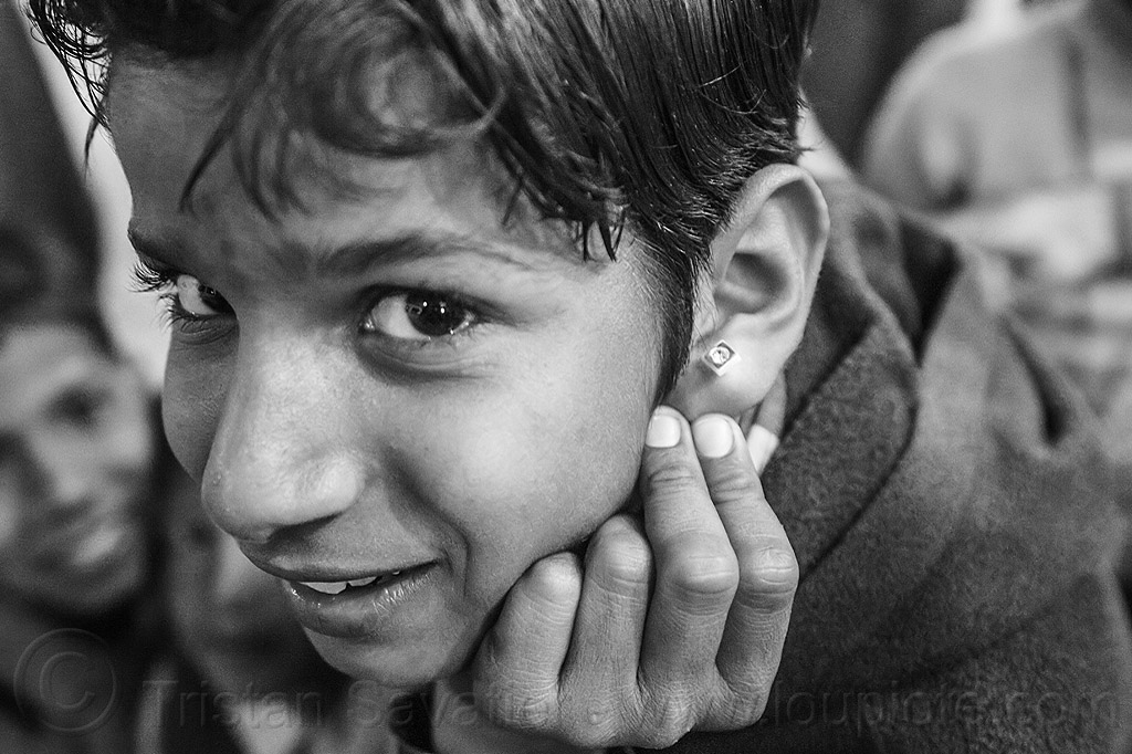 little boy proudly showing his earring, boy, child, ear piercing, earring, hindu pilgrimage, hinduism, india, kid, maha kumbh mela, night, pilgrim, proud, showing