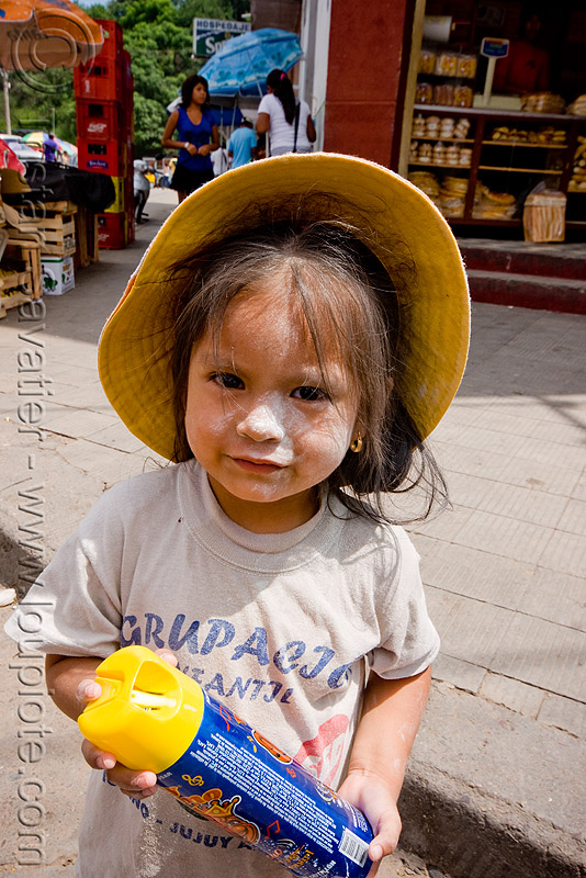 little girl holding party foam spray can - carnaval - carnival in jujuy capital (argentina), andean carnival, child, hat, kid, noroeste argentino, people, san salvador de jujuy