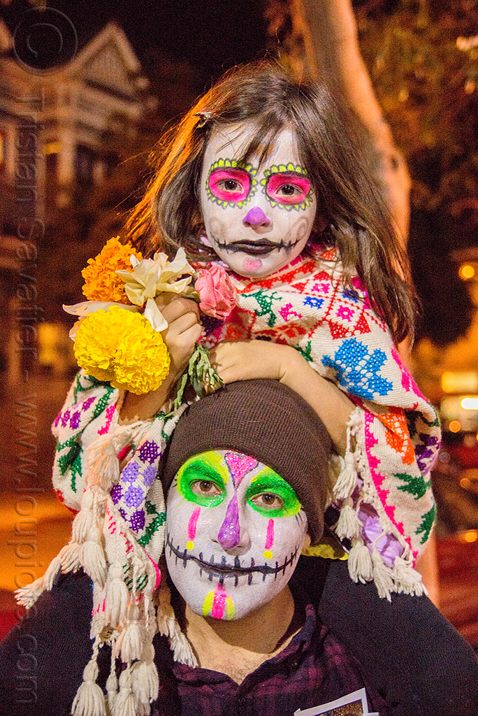little girl with sugar skull makeup - sitting on man's shoulders - dia de los muertos, child, daughter, day of the dead, dia de los muertos, face painting, facepaint, father, flowers, halloween, kid, knitcap, little girl, man, neon colors, night, sugar skull makeup