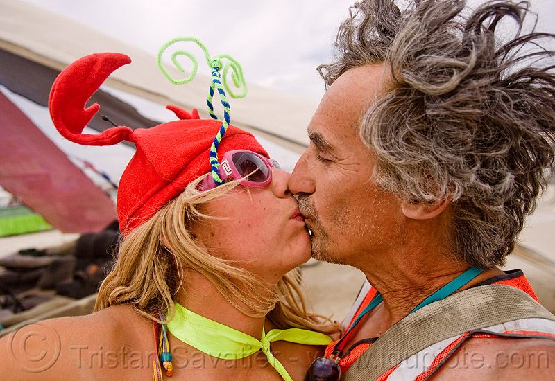 louise and I kissing - selfportrait - burning man 2009, burning man, crab hat, french kiss, kissing, making out, plaha hair, playa-hair, self portrait, selfie, tristan savatier, woman