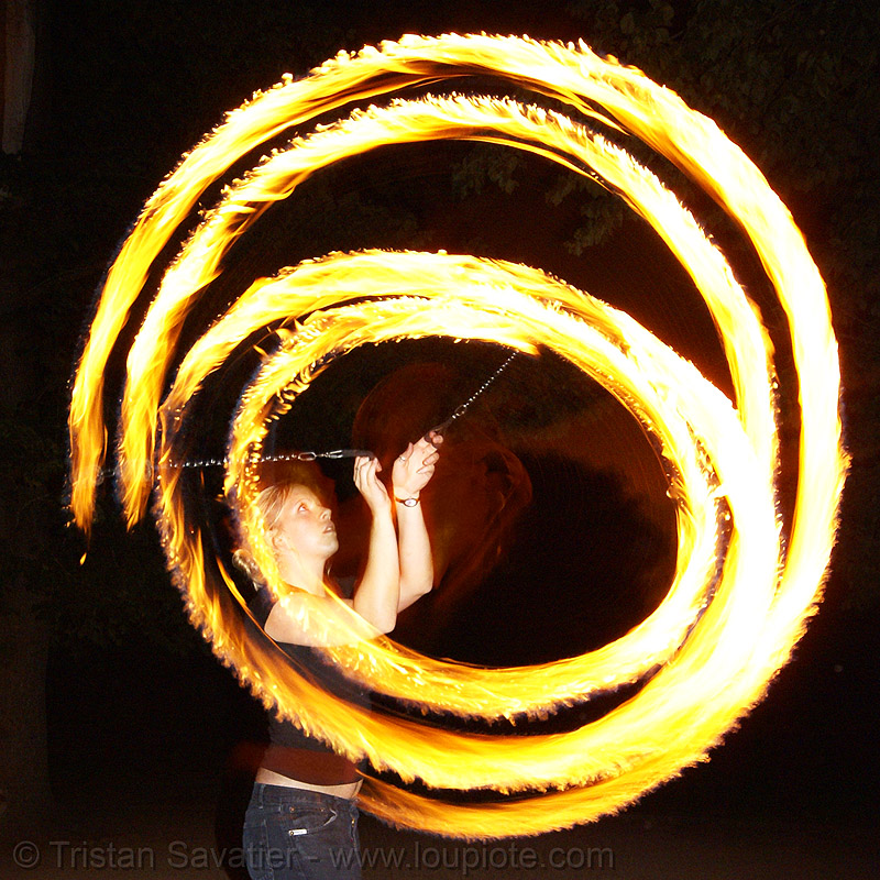 louise spinning fire poi, circle, double poi, fire dancer, fire dancing, fire performer, fire spinning, flames, long exposure, night, people, ring
