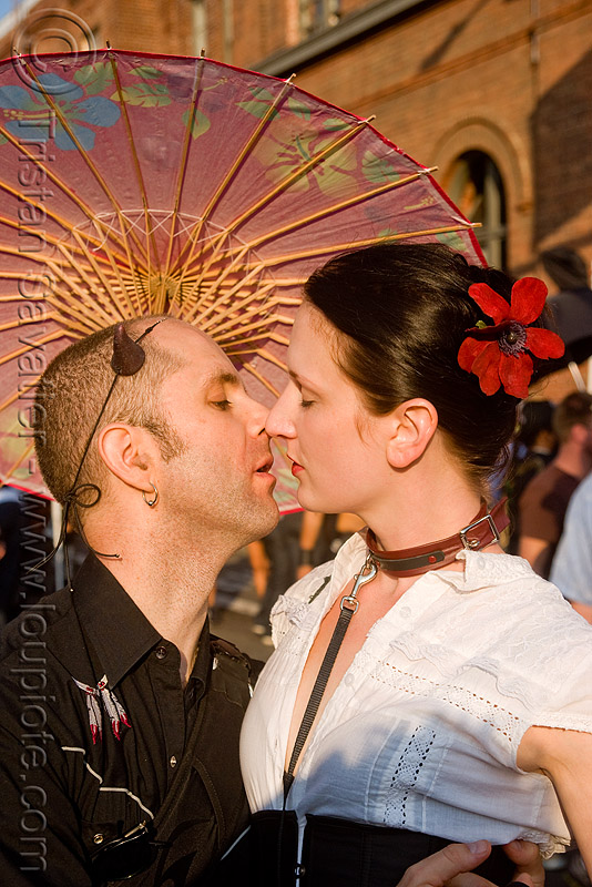 lovers and japanese umbrella - folsom street fair 2009 (san francisco), couple, kiss, kissing, man, people, woman