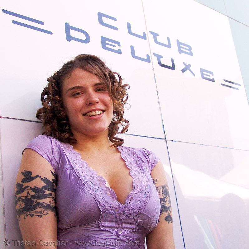 M.C. escher tattoo, arm, birds, breasts, cleavage, club deluxe, emily-ann, fishes, haight, haight street, haight street fair, haight street fair 2007, m. c. escher, people, purple, sky and water, tattooed, tattoos, wall, woman